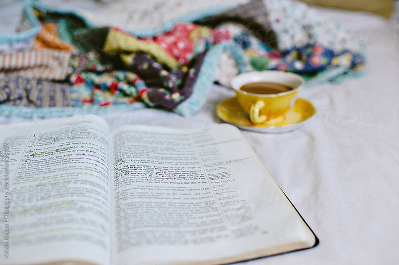 Cozy spot of reading bible and drinking coffee by Kristin Rogers Photography for Stocksy United