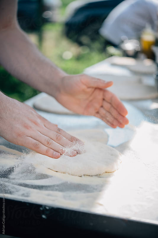 Pizza dough by Adrian Cotiga for Stocksy United