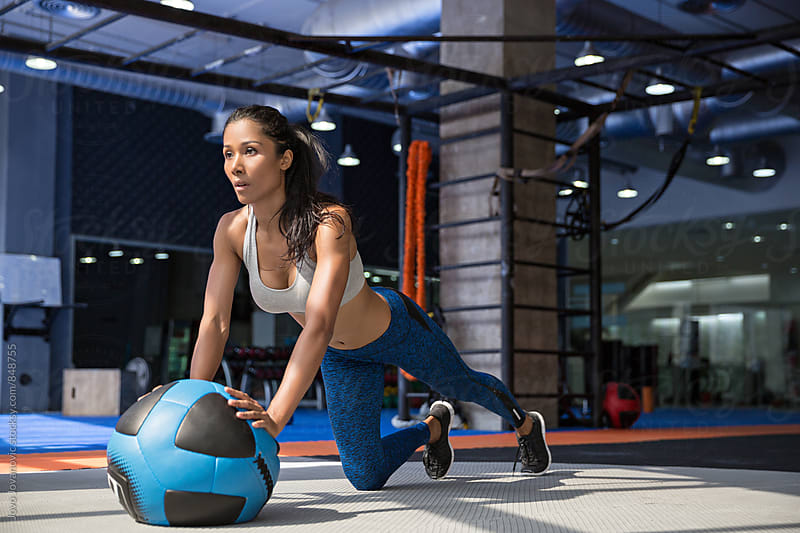 Girl working out using an exercise ball by Jovo Jovanovic for Stocksy United