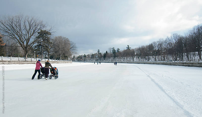 moms skating on the Rideau canal by Margaret Vincent for Stocksy United