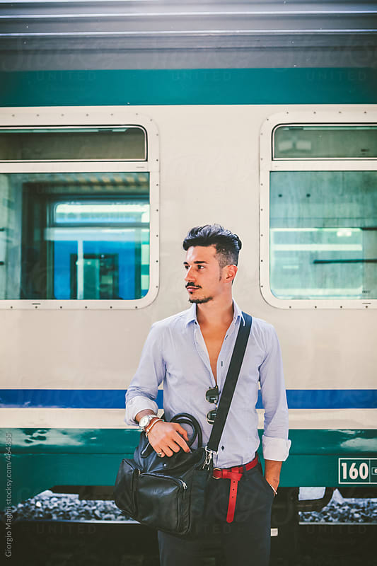 Portrait of an Elegant Trendy Commuter at the Train Station by Giorgio Magini for Stocksy United