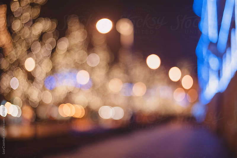 Out of focus christmas light in a city by Lea Csontos for Stocksy United