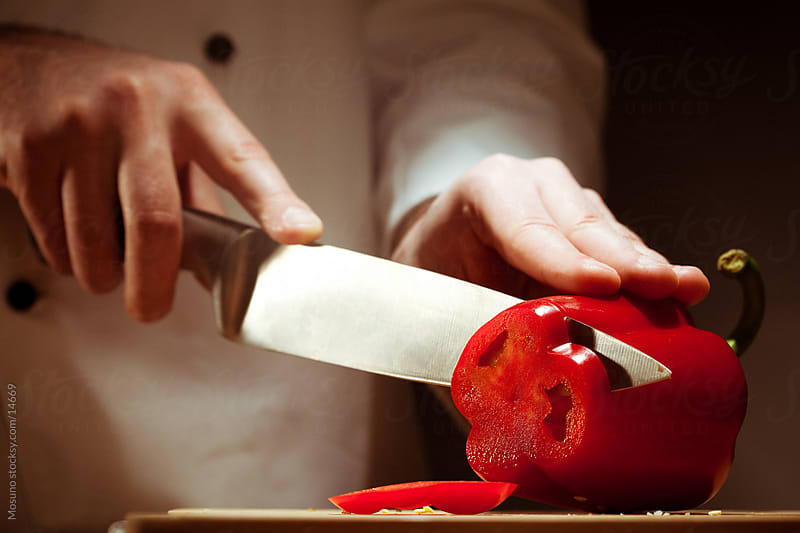 Cutting Bell Pepper by Mosuno for Stocksy United