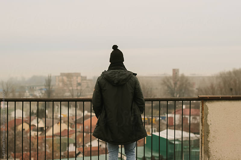 Anonymous male model on the roof by Evil Pixels  Photography for Stocksy United