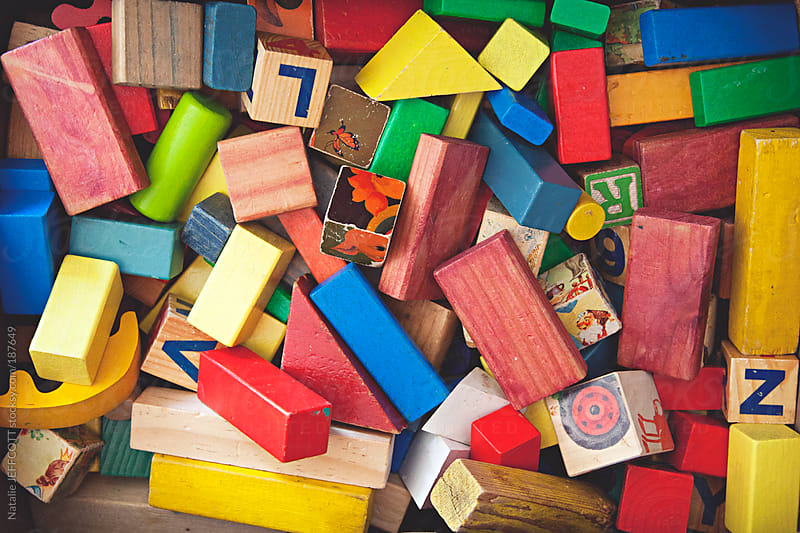 view from above of a collection of children's building blocks by Natalie JEFFCOTT for Stocksy United