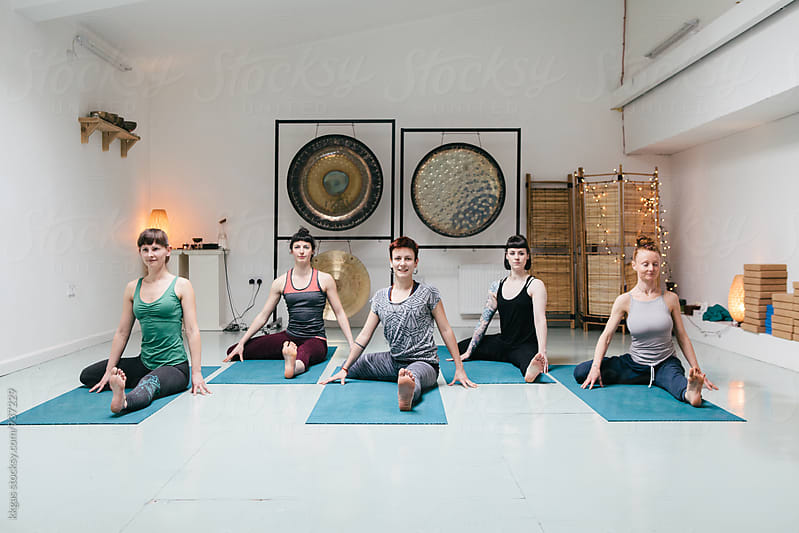 Five women practicing yoga by kkgas for Stocksy United