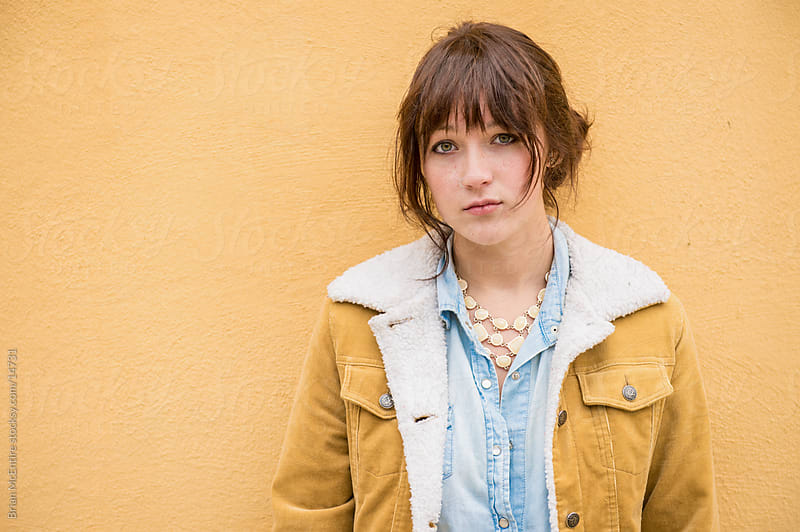 Young Woman in Vintage Fashion, Coat Matches Wall by Brian McEntire for Stocksy United