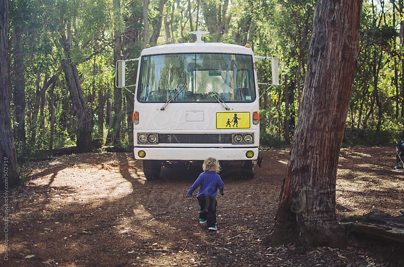 Toddler running to motorhome by Dominique Chapman for Stocksy United