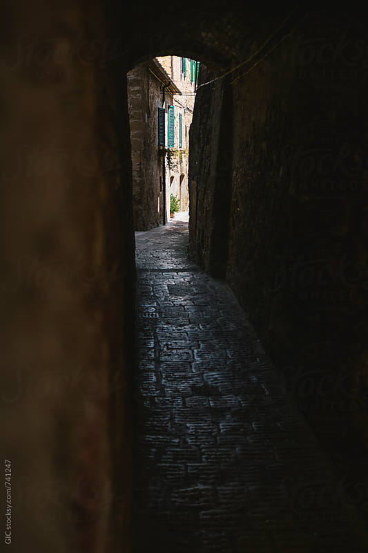 Narrow street in an Italian town by Simone Becchetti for Stocksy United