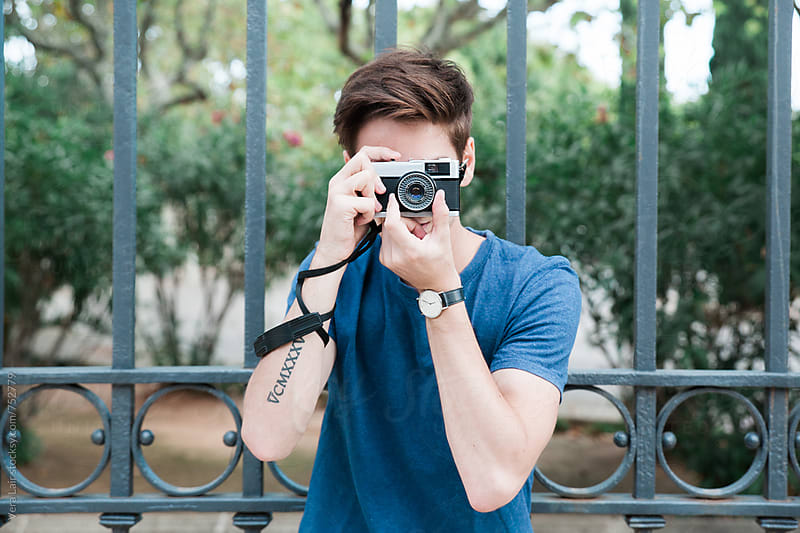Man taking pictures with a vintage camera by Vera Lair for Stocksy United