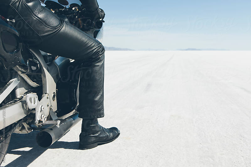 Detail of motorcyclist sitting on bike, preparing to race down playa, Bonneville Salt Flats, UT, USA by Paul Edmondson for Stocksy United