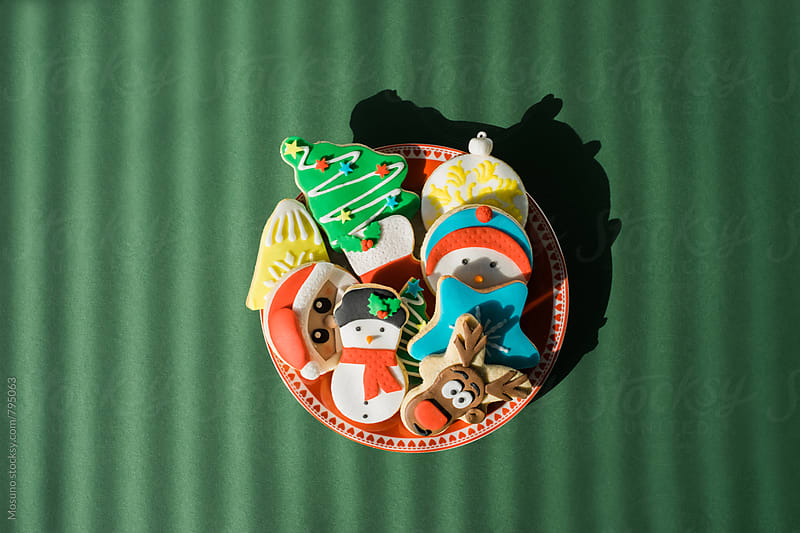 Christmas Cookies on a Green Background by Mosuno for Stocksy United