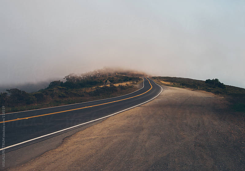 Car Driving Into Fog by VISUALSPECTRUM for Stocksy United