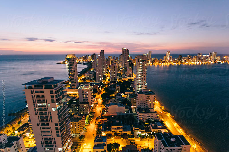 City and sea at night seen from rooftop. Cartagena de Indias, Colombia by Alejandro Moreno de Carlos for Stocksy United