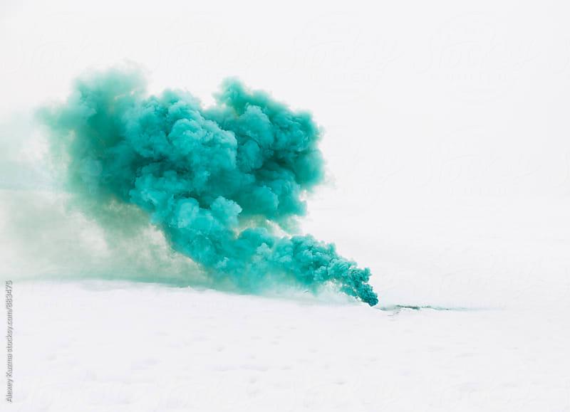 green smoke on the white snow by Alexey Kuzma for Stocksy United