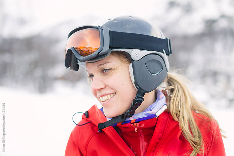 Women with helmet and googles ready for skiing with a smile by Jonas Räfling for Stocksy United