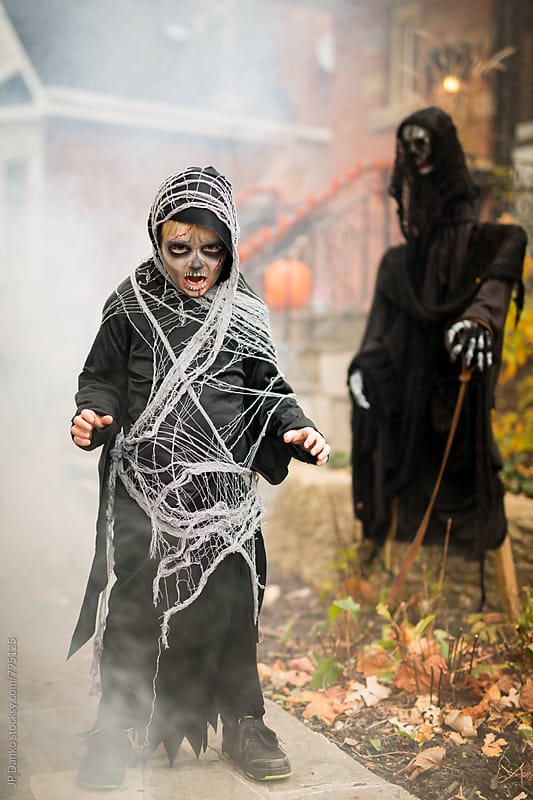 Scary Boy Dressed Up As Grim Reaper Halloween Costume Outdoors at House