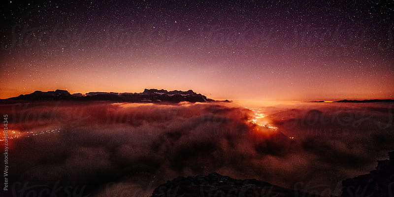 Nightscape above sea of fog by Peter Wey for Stocksy United