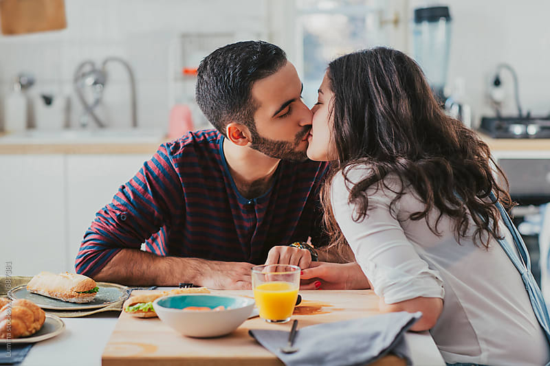 Caucasian Couple in Love Kissing at Home by Lumina for Stocksy United