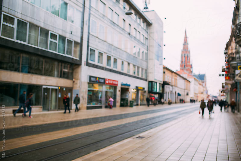 Blurry streets of Osijek by Maja Topcagic for Stocksy United