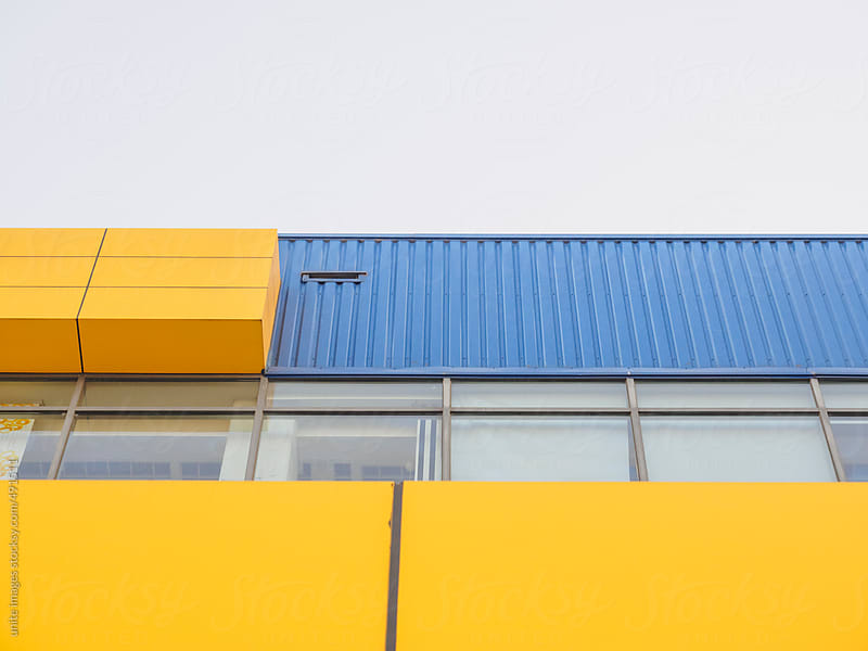 yellow and blue building by unite images for Stocksy United