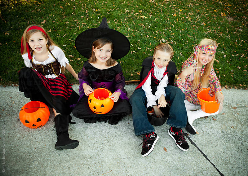 Halloween: Kids Excited for More Trick or Treating by Sean Locke for Stocksy United