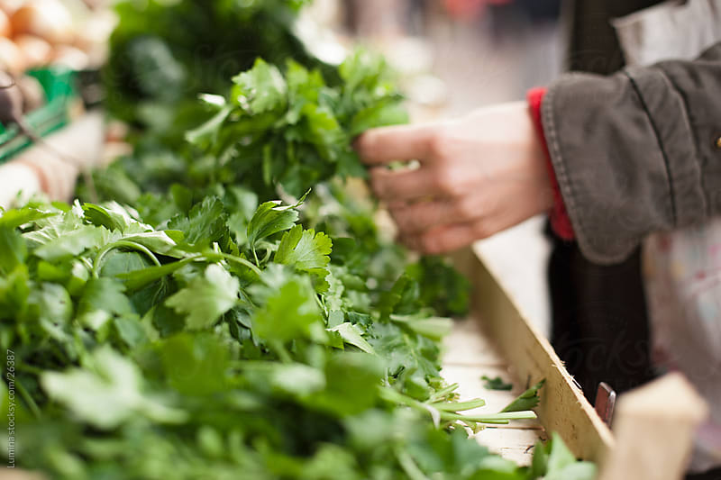 Woman Buying Parsley by Lumina for Stocksy United