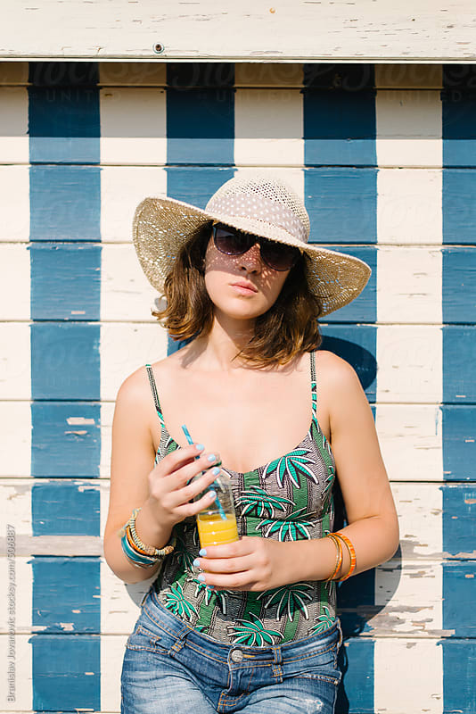 Portrait of a stylish woman at summertime by Brkati Krokodil for Stocksy United