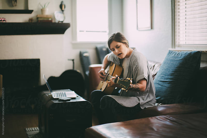 Woman Playing Guitar by Kristopher Orr for Stocksy United