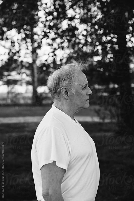 Profile of happy, caucasian senior man outside on warm day by Rob and Julia Campbell for Stocksy United