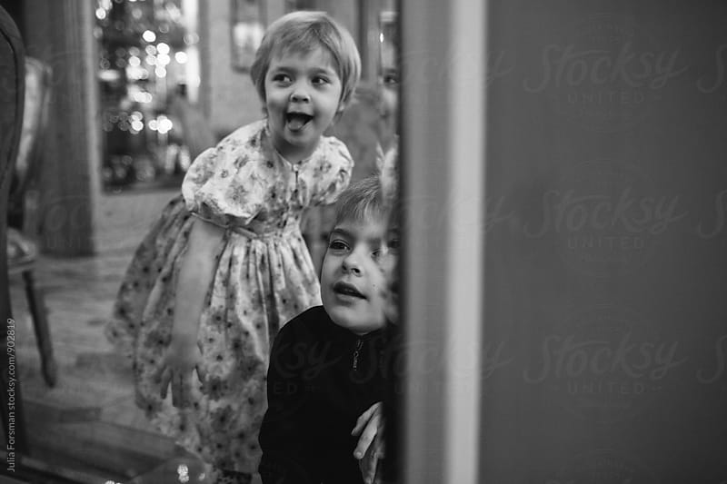 Boy and girl in mirror at beautiful patisserie by Julia Forsman for Stocksy United