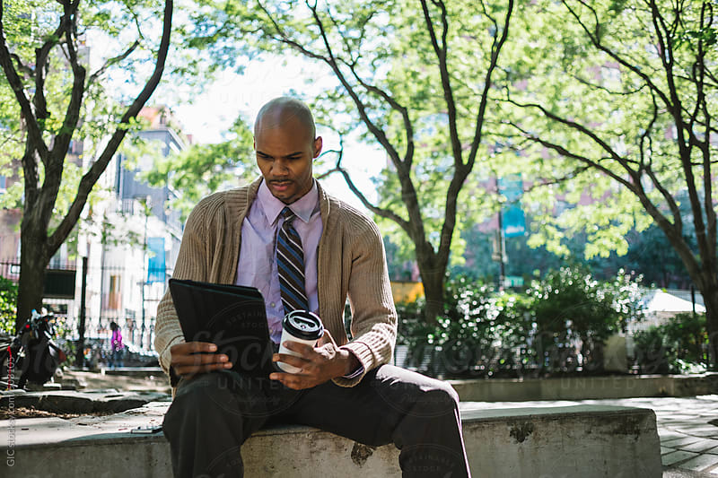 Businessman working outdoors in the park in NYC by GIC for Stocksy United