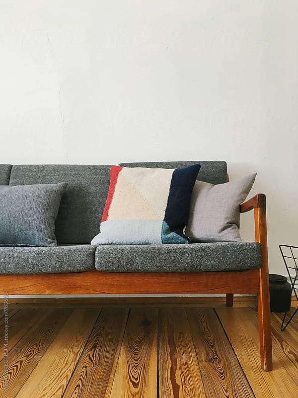Living Room Detail - Stylish Danish Mid-Century Teak Sofa With Patterned Cushion by Julien L. Balmer for Stocksy United