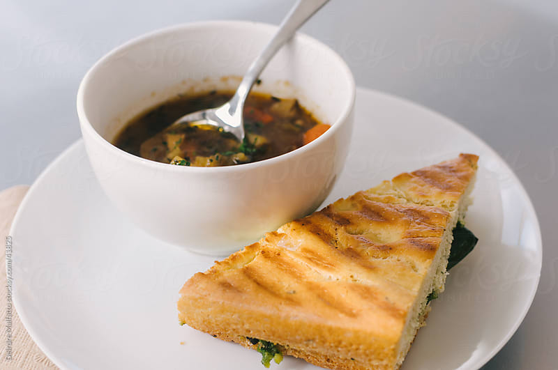 Bowl of vegetable soup and a grilled sandwich. by Deirdre Malfatto for Stocksy United