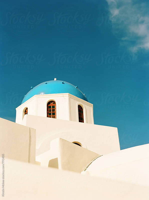 View of blue church dome, Santorini by Kirstin Mckee for Stocksy United