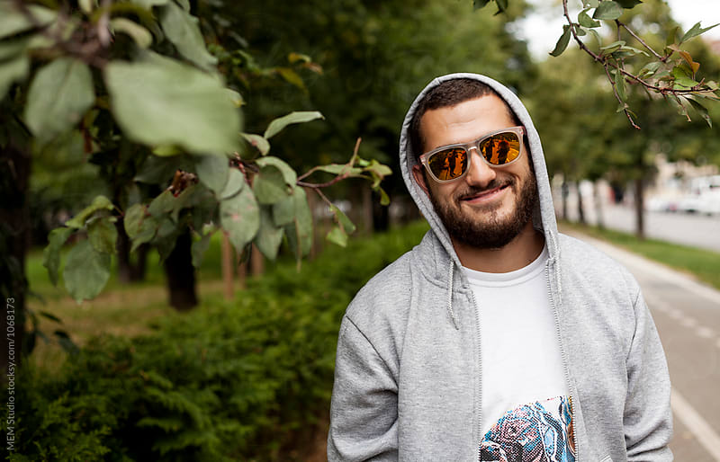 Young beard man with sunglasses and hoodie by MEM Studio for Stocksy United