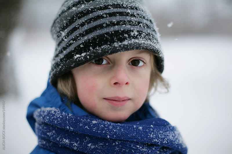 Boy in the Snow by ALICIA BOCK for Stocksy United