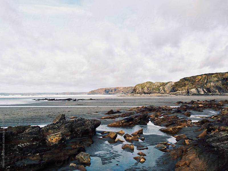 Beach at low tide by Helen Rushbrook for Stocksy United