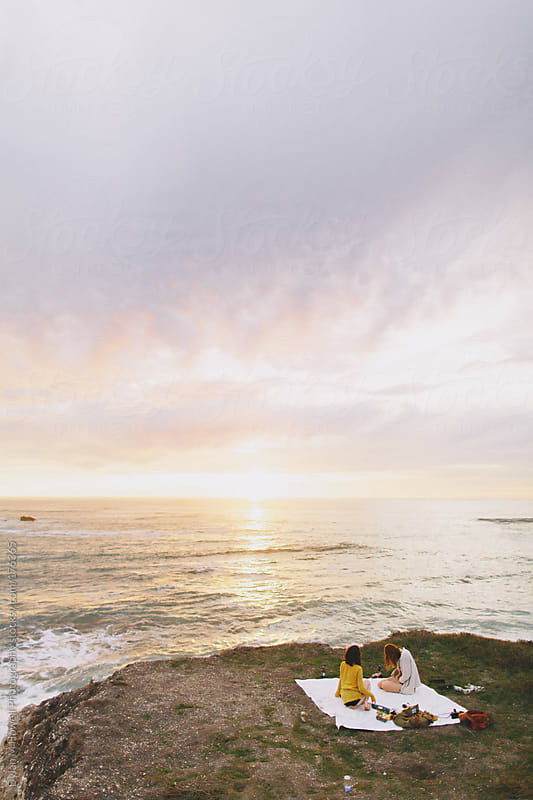 picnic on an ocean cliff by Dylan M Howell Photography for Stocksy United