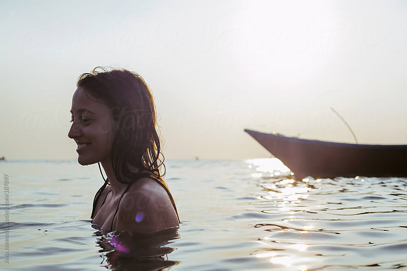 Summertime - woman standing in the ocean by Jovo Jovanovic for Stocksy United