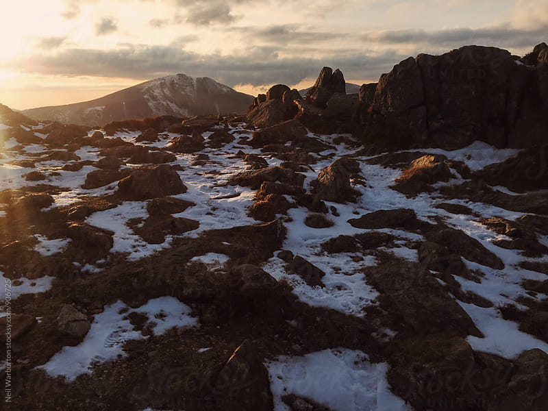 Last Rays of Light over the Mountains by Neil Warburton for Stocksy United