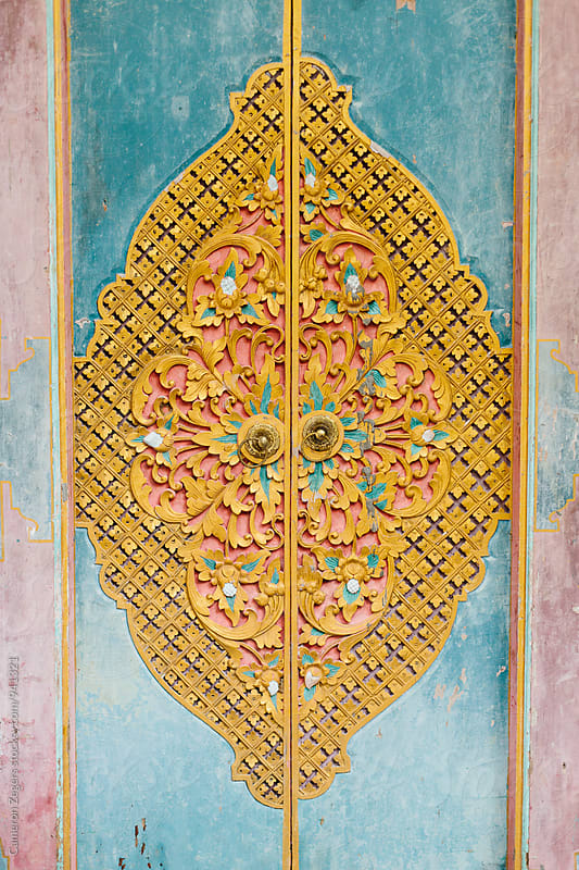 colorful carved wooden door in Bali, Indonesia. by Cameron Zegers for Stocksy United