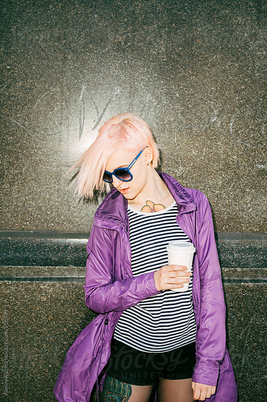 cool young woman with pink hair  by Alexey Kuzma for Stocksy United