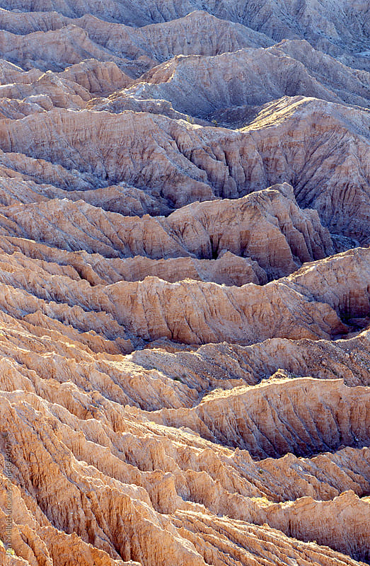 anza borrego desert california sunrise badlands erosion ridges by Ron Mellott for Stocksy United
