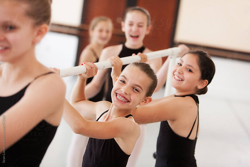 Ballet: Students Moving Barre from Center of Room by Sean Locke for Stocksy United
