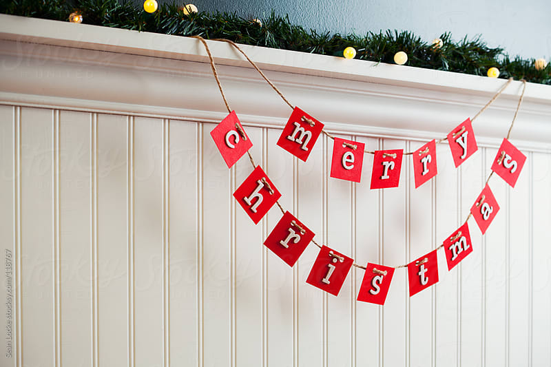 Holidays: Cheerful Merry Christmas Hanging Letters by Sean Locke for Stocksy United