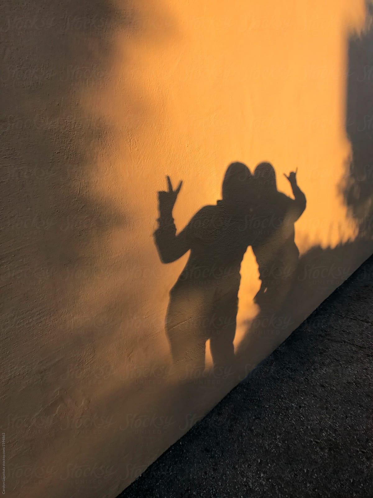Shadows Of Two Friends On A Wall At Dusk By Carolyn Lagattuta Friendship Shadow Stocksy United