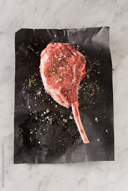 Raw Veal Chop by Jeff Wasserman for Stocksy United