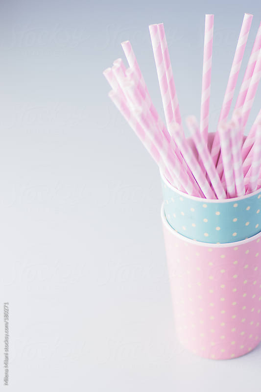 Pink paper straws by Milena Milani for Stocksy United
