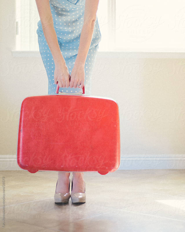 red suitcase, blue dress, lets go! by Tara Romasanta for Stocksy United